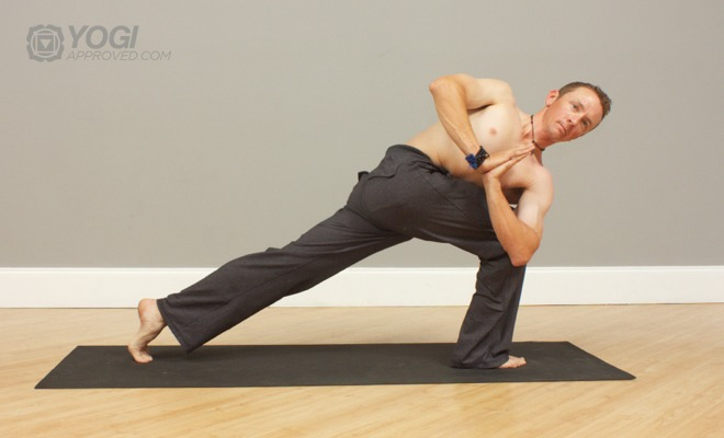 mens prayer twist yoga pose