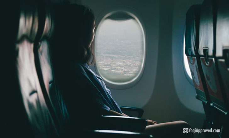 Long Flight? Practice These 9 Yoga Poses in Your Plane Seat to Soothe Your Sore Body
